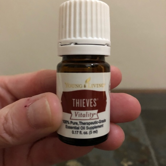 2 Young Living Thieves Essential Oil bottles